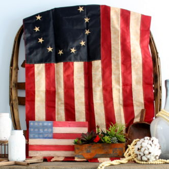 Make a wooden flag for your decor this summer! This pallet flag is perfect for your home decor....indoors or out!