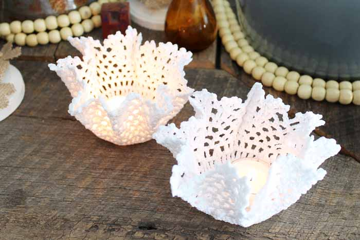 Learn how to stiffen fabric and make these doily candle holders that are perfect for weddings! A quick and easy DIY wedding idea!
