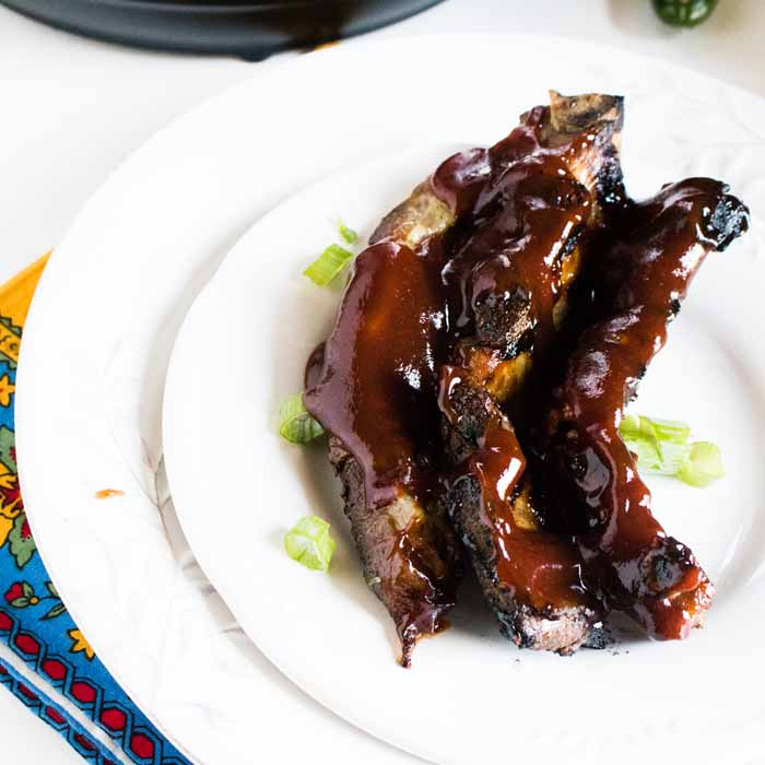 These instant pot ribs are perfect for any summer night! Get the recipe and whip these up in no time at all!