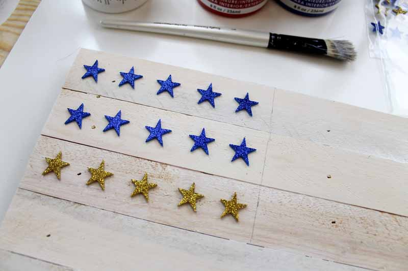 Adding stars by painting a wooden flag