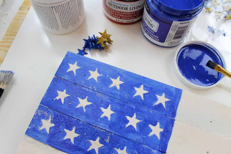 painted blue on a flag from wood