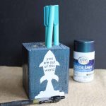 Make this wooden pencil holder for a great Father's Day gift that is easy to make and inexpensive as well! Use your Cricut machine to cut vinyl for the front and use Testors Color Shift paint to give a galaxy look to the entire thing!