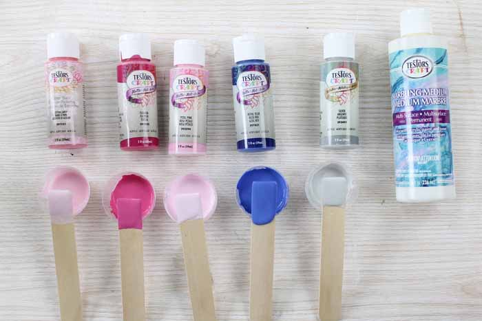 acrylic paint in various colors that has been mixed in small cups