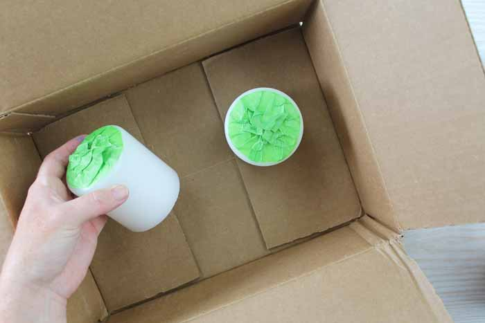 adding taped covered candles to a box