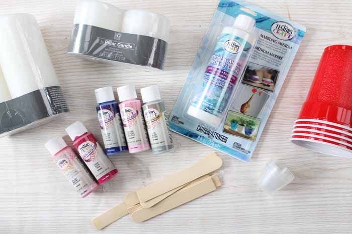 candles with supplies for paint marbling