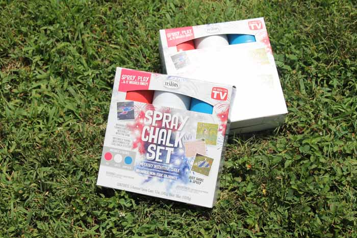 spray chalk in a box on the grass