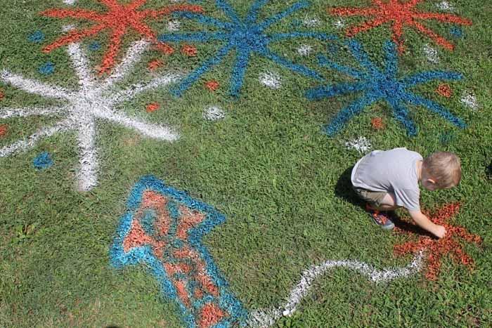 adding chalk spray paint to the grass