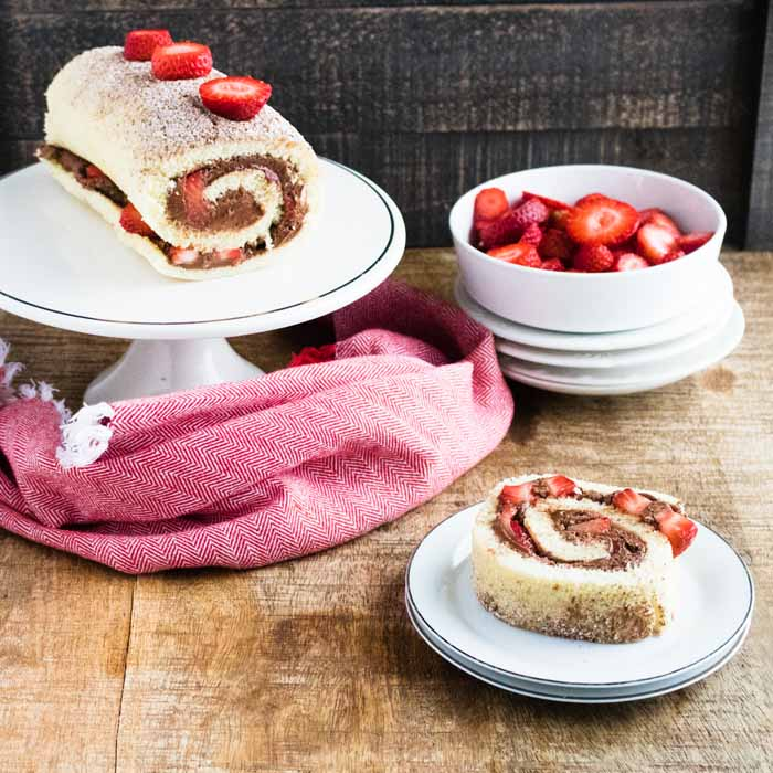 roll cake with chocolate and strawberries