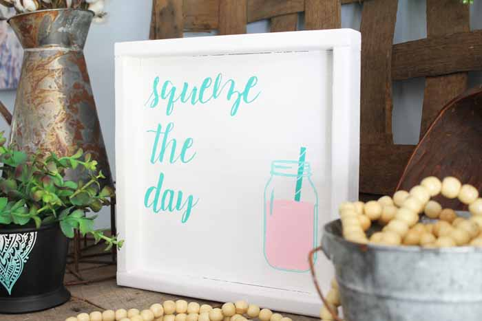 adding chalk couture to a white painted sign