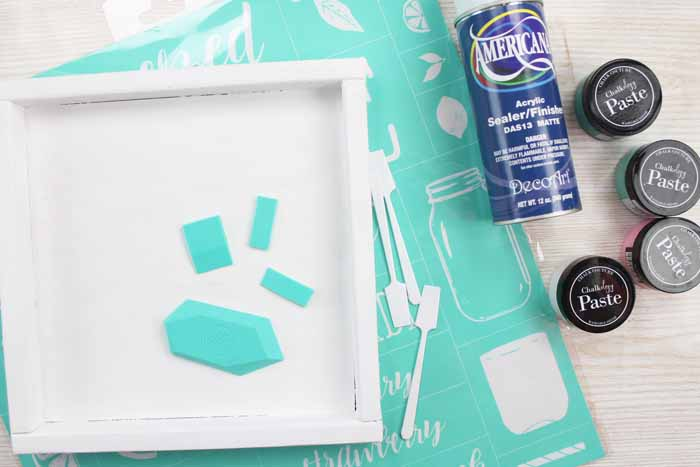 chalk couture supplies on a wood board