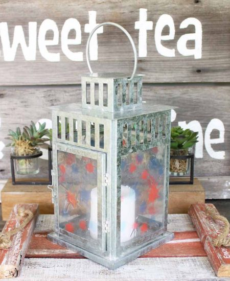 patriotic candle lantern on an outdoor table