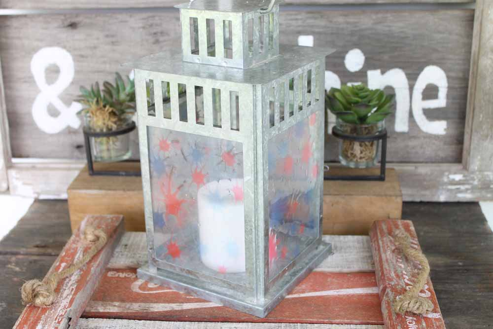 Make this patriotic candle holder from a lantern! Add a fireworks pattern to the sides for a fun Fourth of July decoration!