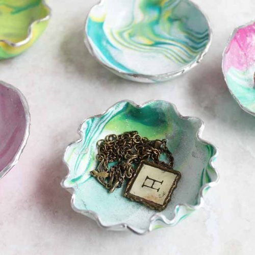 Learn how to make a trinket dish from oven bake clay! These marbled ring bowls make a great gift idea and are perfect for mom!