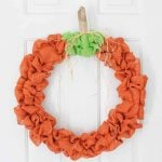 Make this burlap fall wreath for your home this autumn! I love this rustic pumpkin wreath idea!