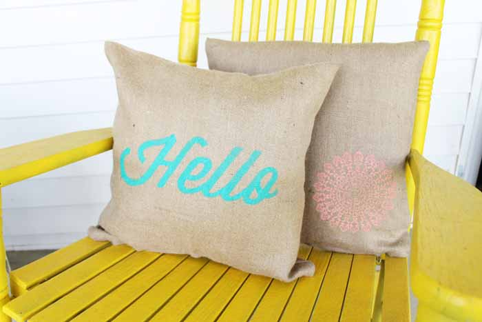 Make these DIY burlap pillows with a few stencils and paint! A quick and easy project for outdoors or any room in your home!