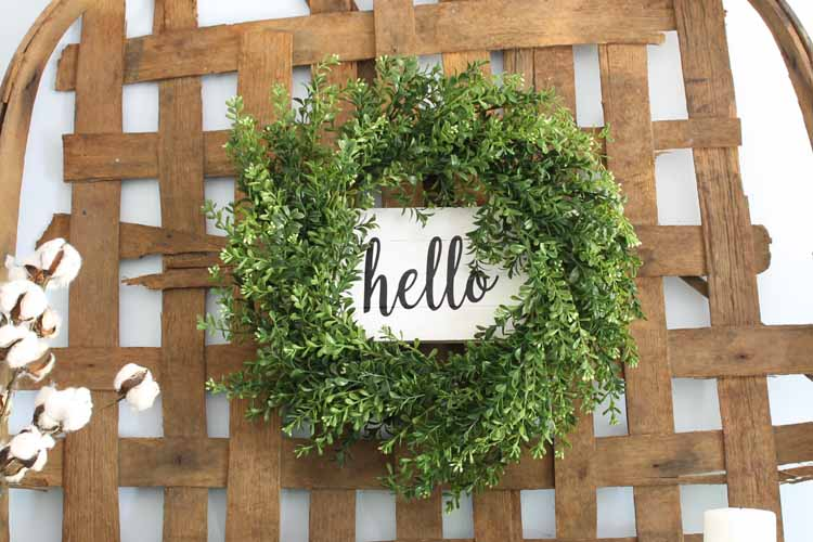 Make this farmhouse wreath for your home with iron-on vinyl! A quick and easy project that uses iron-on directly on wood!