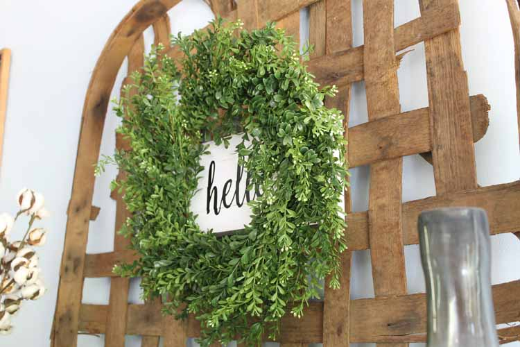 rustic wreath hanging on a tobacco basket