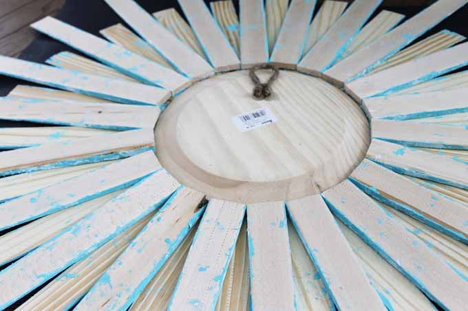 gluing wood shims around a mirror