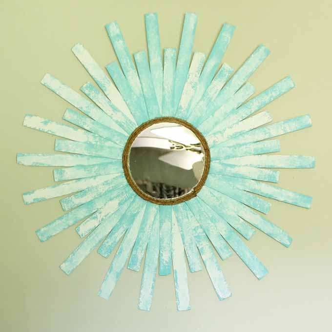 Make this DIY starburst mirror for your home! Plus instructions for making a worn beach paint finish!