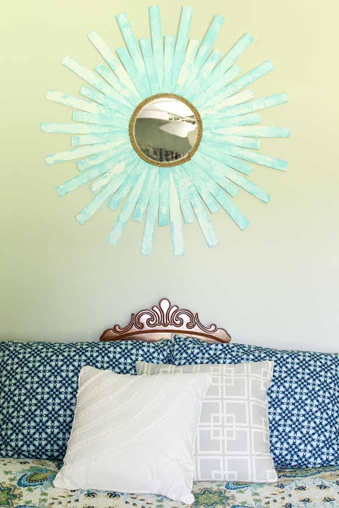 starburst mirror about a bed