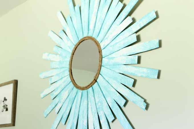 DIY beach paint finish on a starburst mirror
