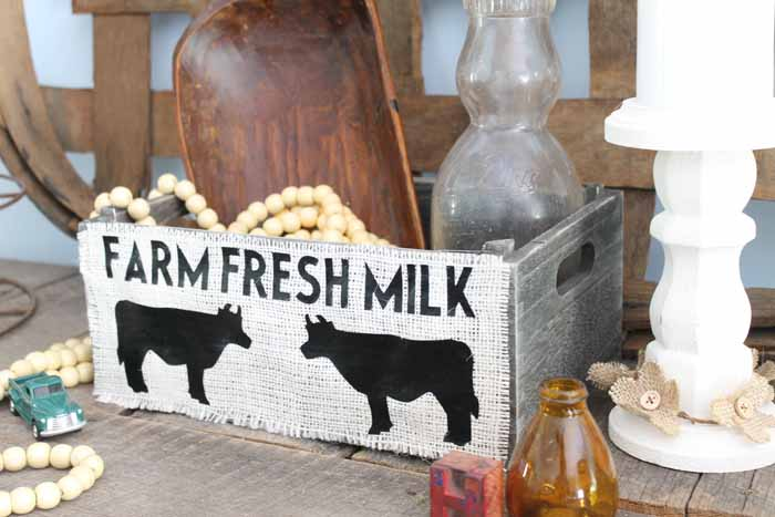 Make this DIY storage box with burlap for your farmhouse style home! If you love cows, this one is for you!