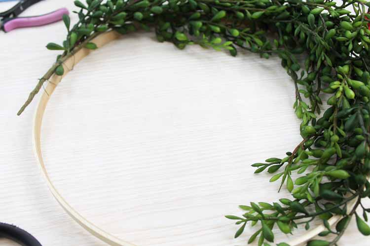 making a farmhouse wreath on a table