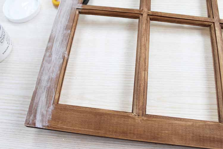 adding rustic paint to a wood window frame