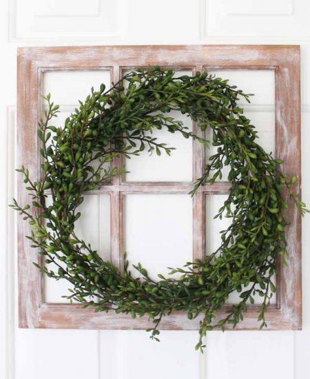 wreath with greenery on a farmhouse window
