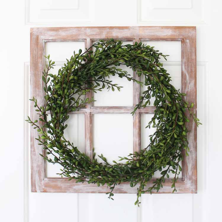 wreath with greenery on a farmhouse window
