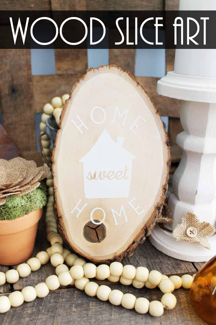 Make this rustic wall art for your home! An easy way to add farmhouse style to any room with a wood slice and some vinyl! Home sweet home never looked so good!