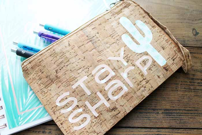Make a custom pencil case with your Cricut machine in minutes! Plus learn how to use iron-on directly on cork!