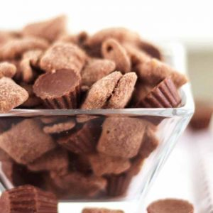 You will love this muddy buddy recipe with Reese's peanut butter cups! This is a great dessert the whole family will love! Chocolate and peanut butter all in one puppy chow recipe!