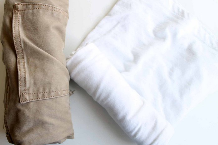 rolling clothes for packing in a suitcase