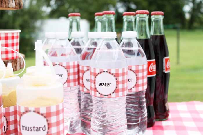 Use these picnic style printable labels to dress up water bottles to match your hot dog bar theme