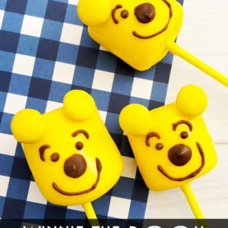 Make these Winnie the Pooh marshmallow pops to celebrate the release of the new Christopher Robin movie!