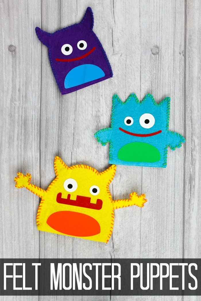 felt monster puppets on a table
