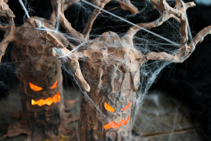 Make a Halloween tree with a toilet paper roll! This easy craft idea will add some fright to your Halloween decor! #halloween #testorscrafternoons #testors #hotglue #gluegun