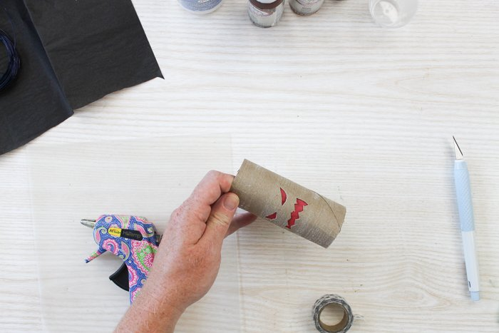 adding paper inside a toilet paper roll