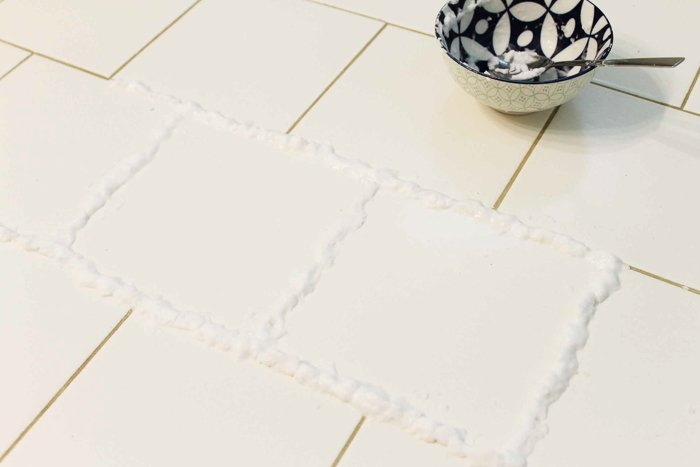Make your own homemade grout cleaner with household supplies! A great way to clean your home naturally! #allnatural #cleaning