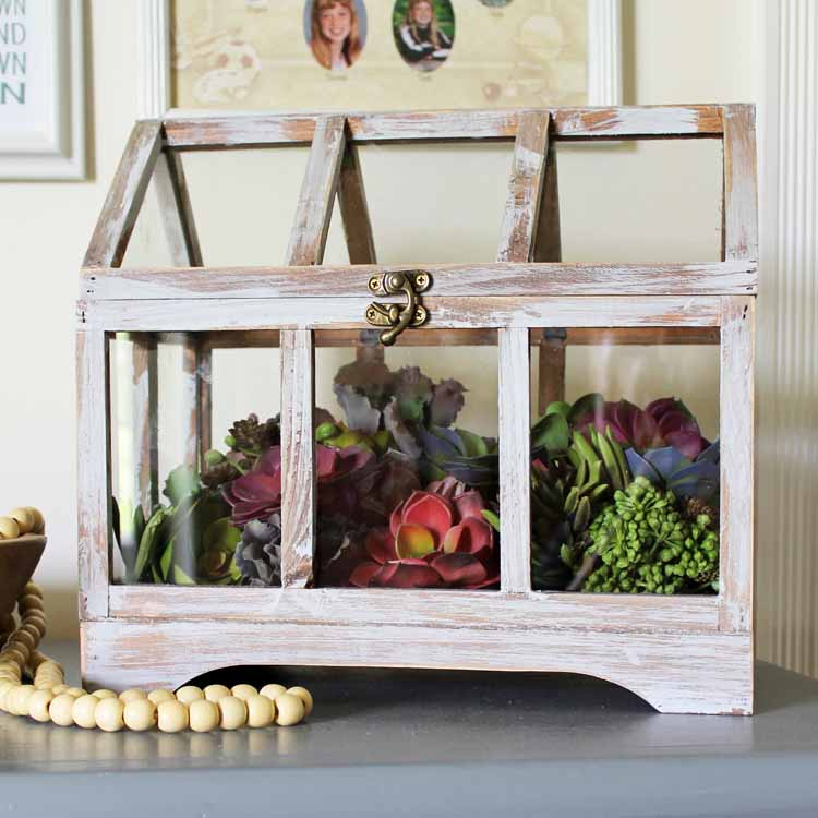 Purchase this large glass terrarium then add in some succulents for a farmhouse style display in minutes! #farmhouse #farmhousestyle #terrarium #succulents