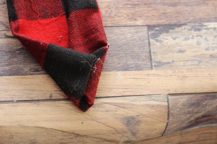 Buffalo check plaid fabric in red and black to make the hat for a Christmas gnome.
