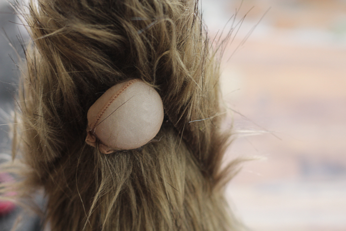Secure the nylon ball to the beard of your Christmas gnome for a cute little nose