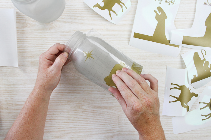 using transfer tape to add vinyl to Christmas jars