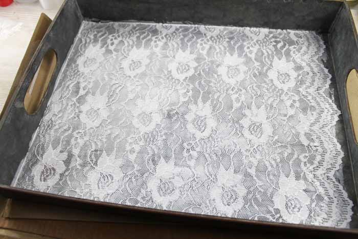 adding decoupage over lace on the bottom of a metal tray