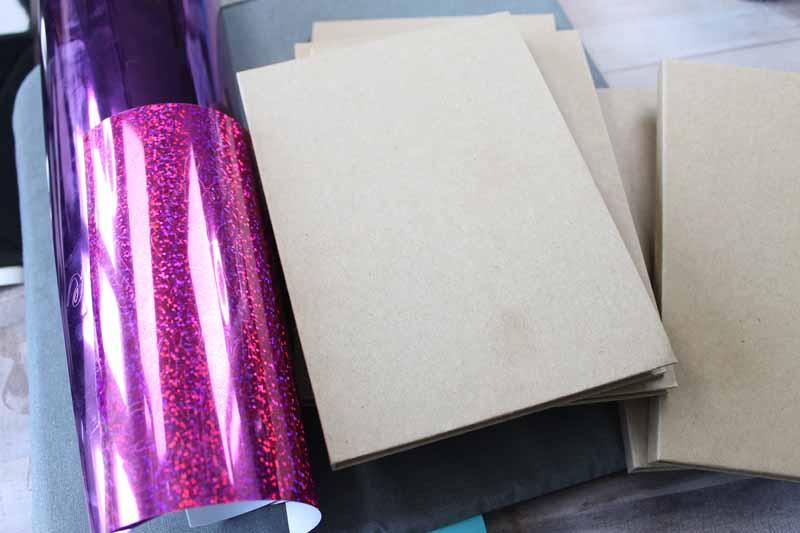 Adding heat treat vinyl to a notebook.