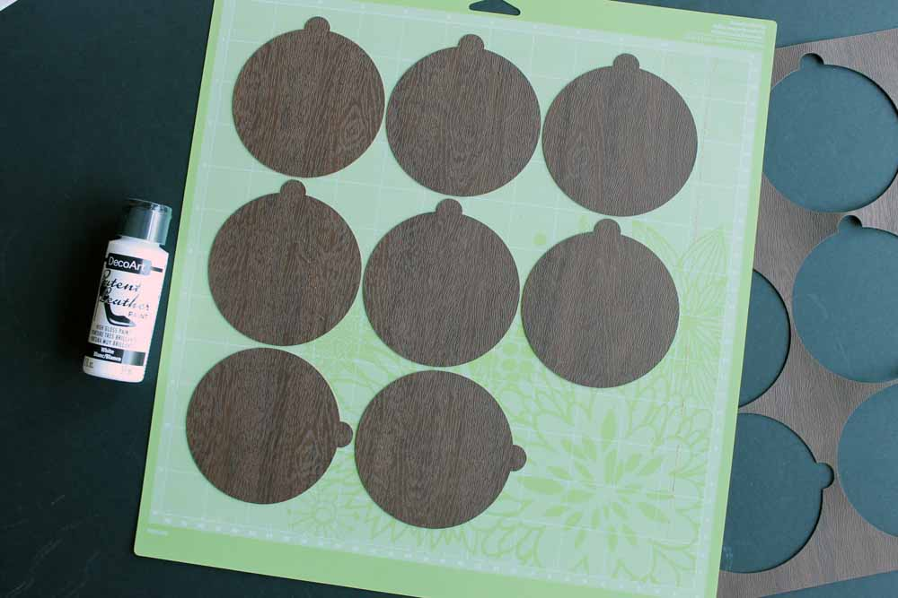 Cutting handmade ornaments on the Cricut machine.