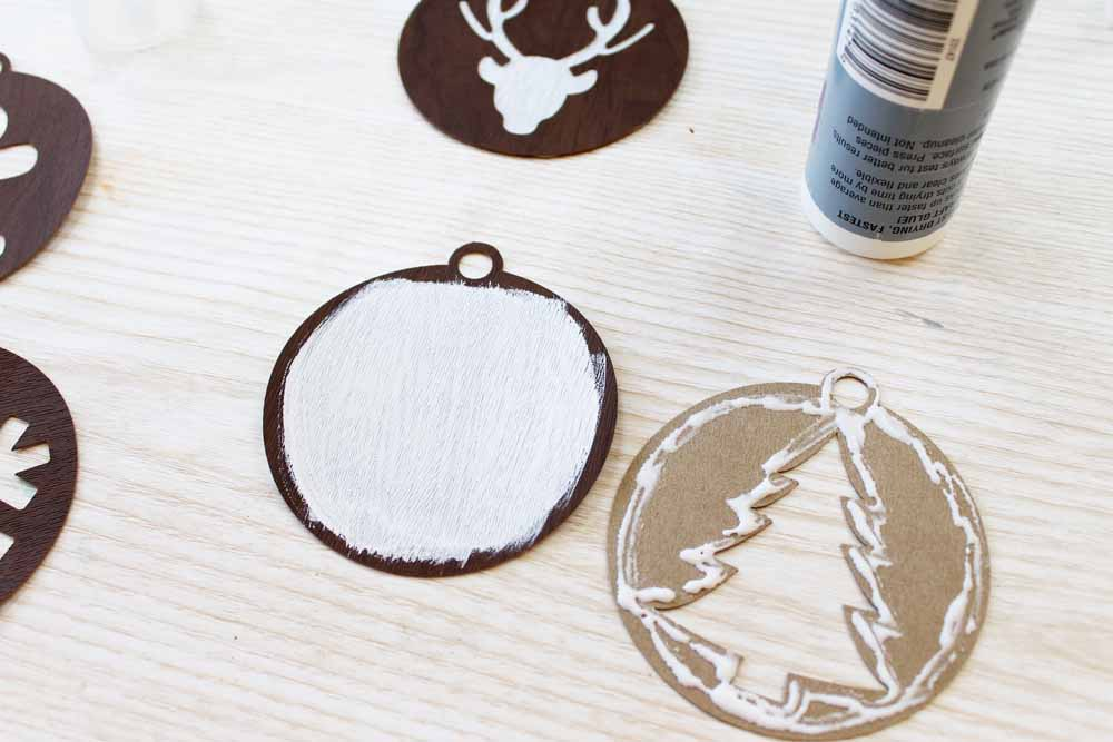 Gluing handmade ornaments together.