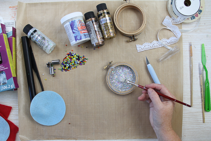 Adding Glitterific paint to a Christmas ornament
