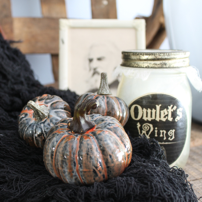 Make marbled pumpkins in minutes with resin! These glossy pumpkins are perfect for Halloween! Grab some other colors to make a version for fall! #pumpkins #halloween #marbled